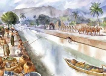 Suasana kanal di Ibu Kota Majapahit Trowulan dalam poster National Geographic Indonesia, September 2102. Jaringan kanal kuno ini mulai diketahui setelah adanya kajian foto udara dan endapan pada 1983. Kanal dibangun sebagai adaptasi musim warga Majapahit.(Sandy Solihin/NGI)