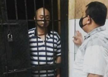 JT pelaku penganiayaan perawat CRS saat berada di dalam ruang sel tahanan Mapolrestabes Palembang.(HANDOUT)