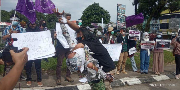 Foto; Aksi Solidaritas AJi kota Jambi dan FPJM